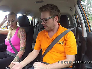 Breasty inked driving student banging in public