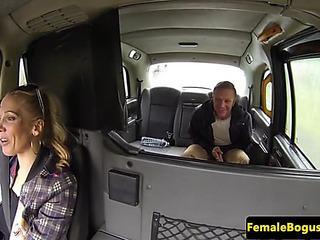 Bigtitted british cabbie rides taxi passenger