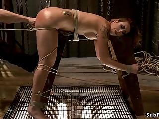 Suspended blonde pussy toyed